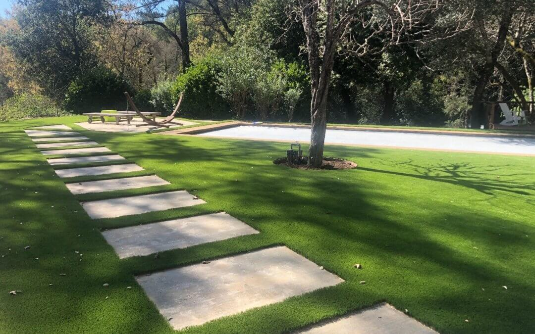 Stone Landscaping Ideas for Synthetic Grass Installation